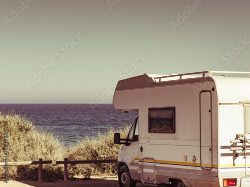 Camper car on beach, camping on seashore Canvas