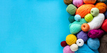 Knitting Flat Lay. Various Colored Balls Of Yarn On A Blue Background. Space For Text