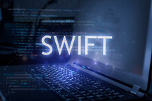 Swift Inscription Against Laptop And Code Background. Learn Swift Programming Language, Computer Courses, Training.