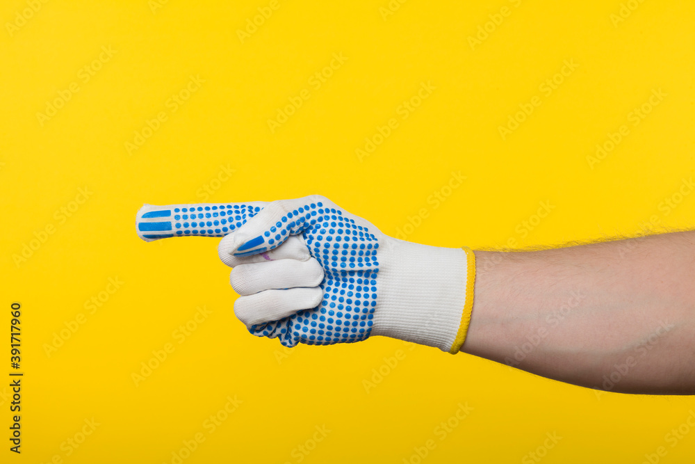 Fototapeta Worker work glove isolated on yellow background
