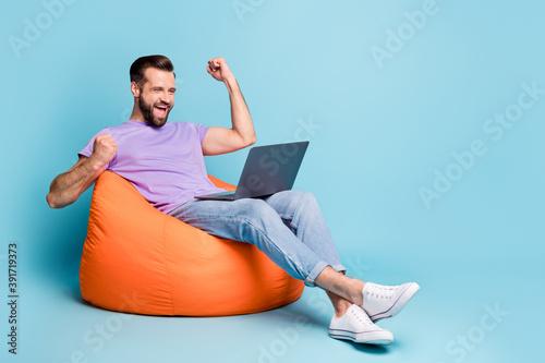 Obraz Full length body size photo of bearded freelancer gesturing like winner laptop isolated on vibrant blue color background - fototapety do salonu