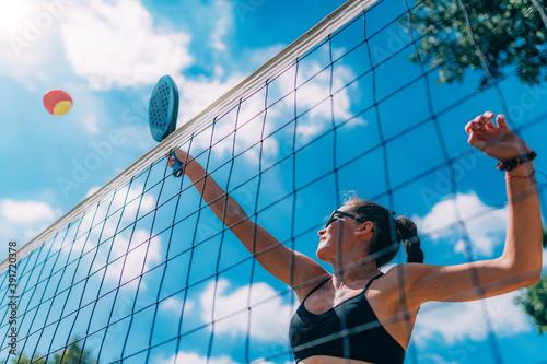 Obraz Beach Tennis Player at the Net - fototapety do salonu