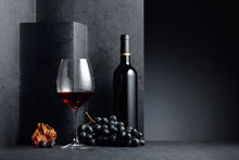Red Wine And Blue Grapes With ...