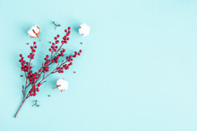 Christmas Composition. Red Berries, Cotton Flowers On Blue Background. Christmas, Winter, New Year Concept. Flat Lay, Top View