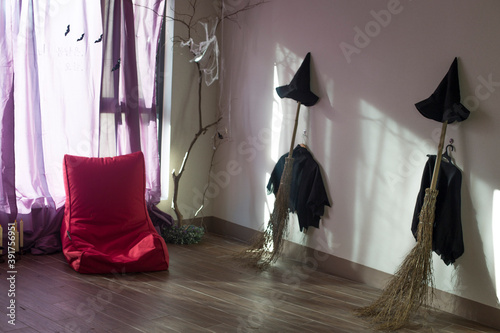 Halloween photo with witch hat and clothes with broom. Fototapeta