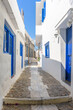 Traditional cycladitic alley with narrow street and whitewashed houses in ano Syros Greece