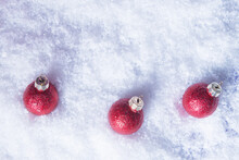 Three Red Christmas Balls In S...