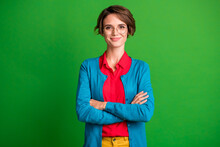 Photo Of Young Attractive Girl Happy Positive Smile Confident Folded Hands Isolated Over Green Color Background