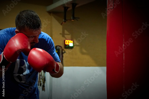 Side view of confident male boxer exercising in gym