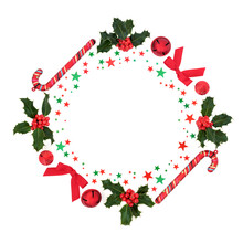 Christmas Wreath With Holly, Bauble Decorations & Red & Green Stars On White Background. Festive Concept For The Xmas Season. Flat Lay, Top View, Copy Space.