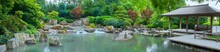 Beautiful Japanese Garden With Pond And Hut, In Panorama Format