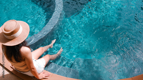 Canvastavla Young asian Beautiful woman relaxing in swimming pool at spa resort