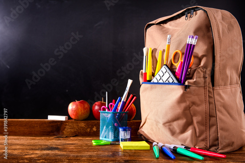 School blackboard with attributes and learning supplies
