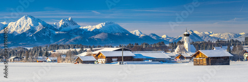 Valokuva panoramic landscape at winter with alps mountains in Bavaria