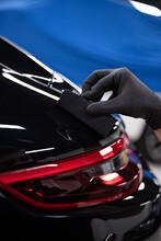 Car Detailing Studio Worker Applying Car Ceramic Coating