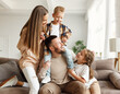canvas print picture happy family mother father and kids having fun at home on couch .