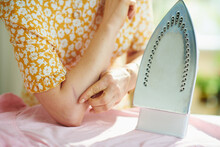 Woman At Home In Sunny Day Hav...