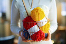 Closeup On Modern Woman Holding Basket With Yarn And Needles