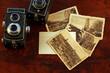 Leinwandbild Motiv Old, vintage TLR camera - twin lens reflex and old postcards