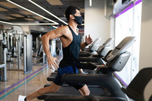 Strong Young Latin Man Focused On Running In A Treadmill