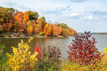 Colorful Autumn Foliage Surrounds The Shores Of Eagle Creek Reservoir In Indianapolis, Indiana.