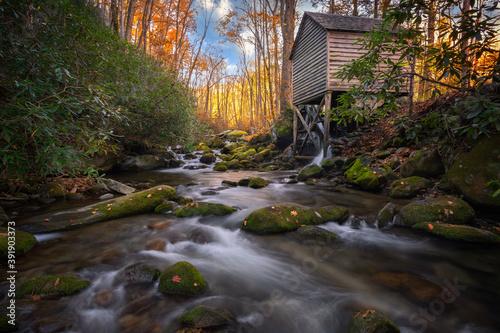 Fototapeta Water mill next to stream in autumn
