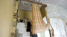 The Hanging Curtain Of The Room In The Abandoned House With The Rubbles On The Floor
