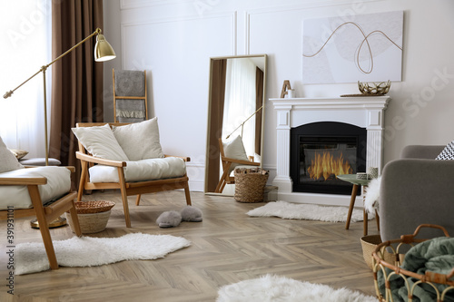 Fototapeta Beautiful living room interior with fireplace and armchairs obraz