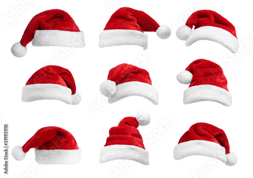 Fototapeta Set of red Santa hats on white background obraz