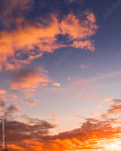 Fototapety, obrazy: Colorful orange-purple dramatic clouds lit by the setting sun against the evening sunset sky.