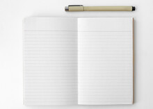 Blank Plain White Notebook Page With A Pen