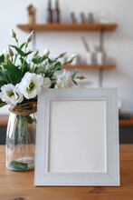 White Wooden Frame On The Table In The Provence Kitchen. Blank For Design