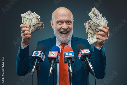 Fototapeta Greedy politician holding cash money