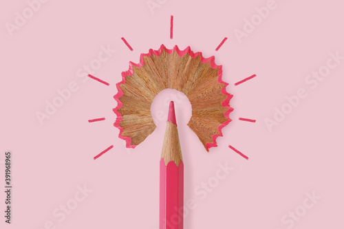Fototapeta Pink pencil like a light bulb on pink background - Concept of women and creative thinking obraz