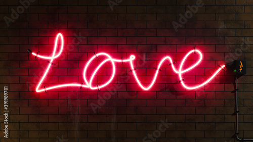 Love sign neon letters at a brick wall