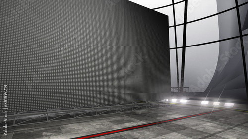 Obraz Angle view of a Virtual studio background with a big empty videowall display ideal for tv shows, commercials or events. Suitable on VR tracking system stage sets, with green screen. (3D rendering) - fototapety do salonu