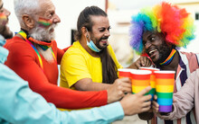 Happy Multiracial People Cheering And Drinking Cocktails In Gay Pride Festival Event