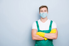 Portrait Of Confident Janitor Wearing Blue Face Mask Standing With Folded Arms Isolated On Gray Background With Blank Space