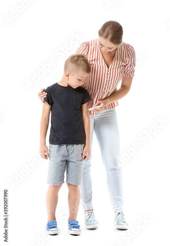 Mother giving her diabetic son insulin injection on white background Fototapeta