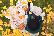 Woman Resting In Autumn Park, Top View