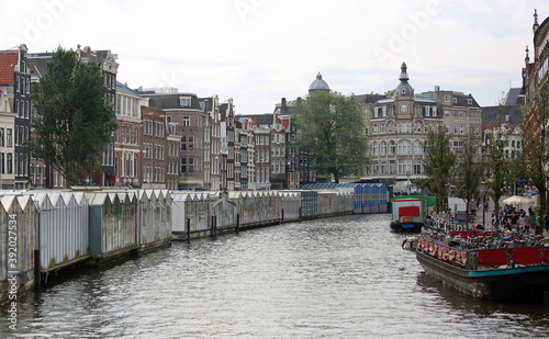 waterway in Amsterdam and houseboats with the flower market Canvas
