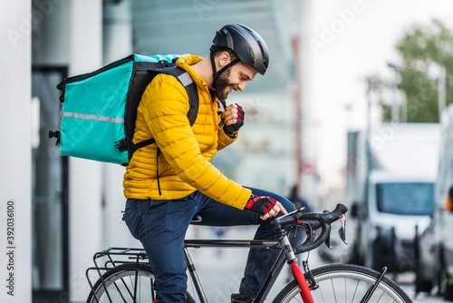Fotografiet Food delivery, rider with bicycle delivering food