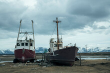 Ships Moored At Beach Against Cloudy Sky