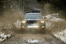 Off-road Car Splashing Dirt On...