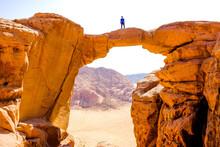 A Man Stands Atop A Rock Bridg...