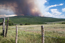 Landscape With Smoke Emitting From Wildfire In Background