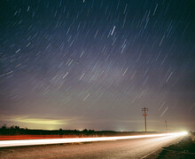 Star Trails Above Road With Long Exposure Car And Telephone Pole