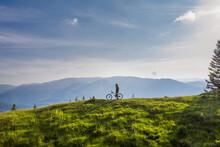 Mountain Biker On His Bike On ...