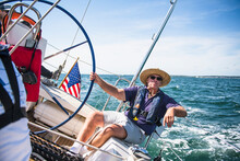 Middle Aged Man Sailing On A Sunny Day