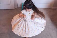 Preschool Twirling In Her Bedroom, Wearing A Polka Dot Dress.